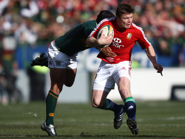 British and Irish lions player Brian O'Driscoll tries to break through a tackle from South Africa's Adi Jacobs on June 27, 2009