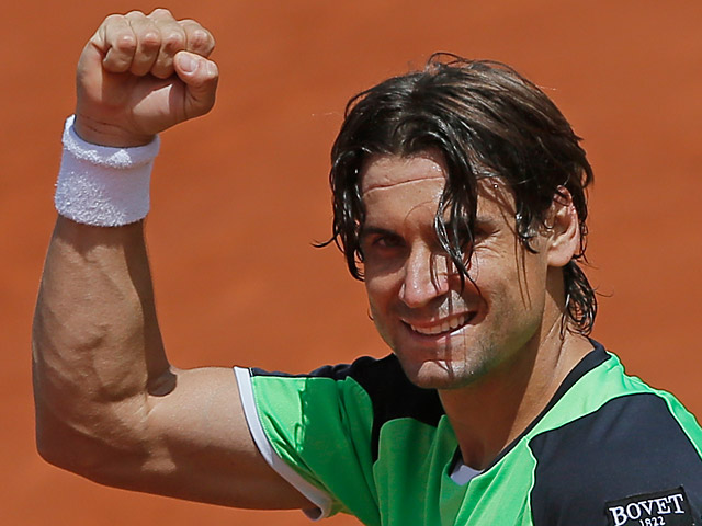 David Ferrer celebrates after defeating Kevin Anderson during their fourth round match of the French Open on June 2, 2013