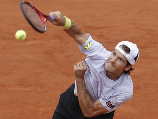 Germany's Tommy Haas serves against France's Guillaume Rufin during their first round match at the French Open tennis tournament on May 28, 2013