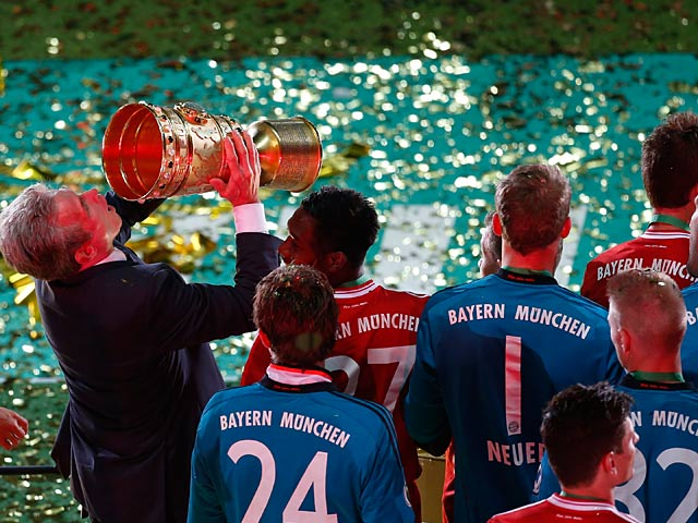 Bayern boss Jupp Heynckes celebrates with the cup after his team won the German Soccer Cup against Stuttgart on June 1, 2013
