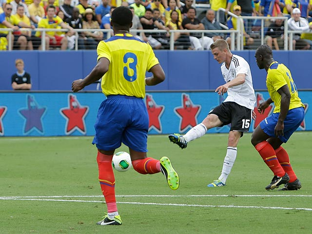 Germany's Lars Bender scores his team's second goal against Ecuador on May 29, 2013