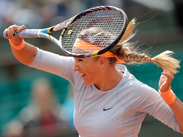 Victoria Azarenka returns the ball to Elena Vesnina during their first round match of the French Open on May 29, 2013