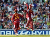West Indies' Kemar Roach and Denesh Ramdin celebrate their victory during the ICC Champions Trophy match against Pakistan on June 7, 2013