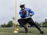 Lions' RB Reggie Bush runs a practice drill on May 30, 2013