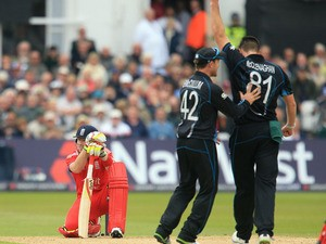 England's Ian Bell sinks to his knees after being caught out off the bowling of New Zealand's Mitchell McClenaghan during the third ODI on June 5, 2013