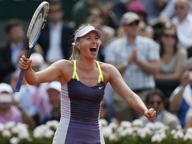 Russia's Maria Sharapova celebrates winning against Serbia's Jelena Jankovic in three sets during their Quarter Final match of the French Open tennis tournament on June 5, 2013