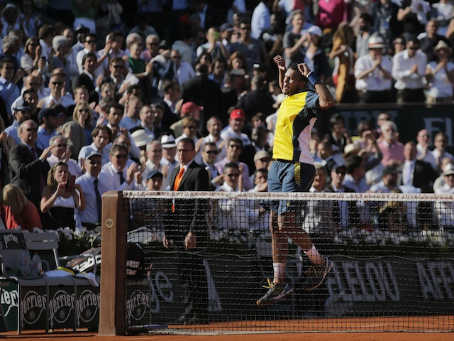 Jo-Wilfried Tsonga celebrates his French Open win over Roger Federer on June 4, 2013