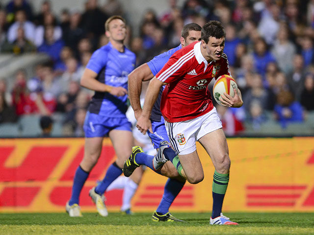 The British and Irish Lions' Jonathon Sexton runs his way to scoring a try during their rugby union tour match against the Force on June 5, 2013