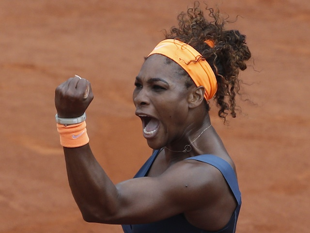 Serena Williams celebrates winning the first set of the French Open final against Maria Sharapova on June 8, 2013