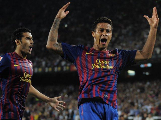 Thiago celebrates his goal for Barcelona with Pedro.
