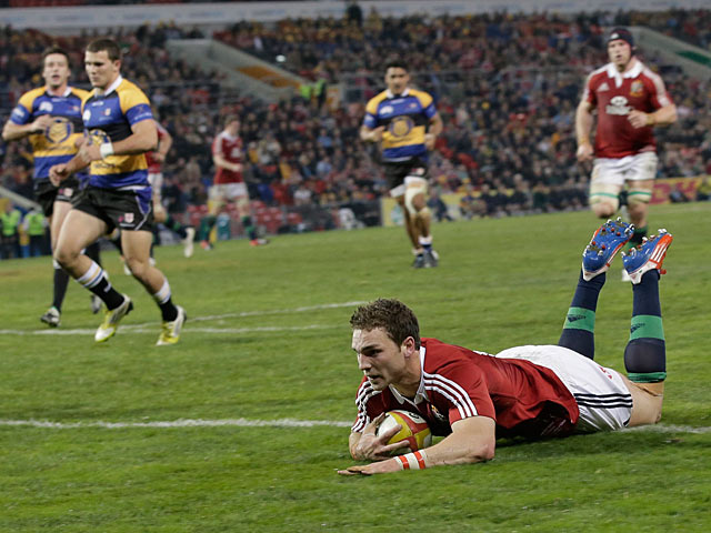 British and Irish Lions George North slides in to score a try against Combined Country on June 11, 2013