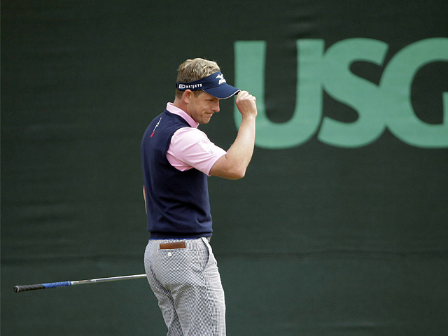 Luke Donald reacts after his birdie on the 13th hole during the second round of the US Open on June 14, 2013
