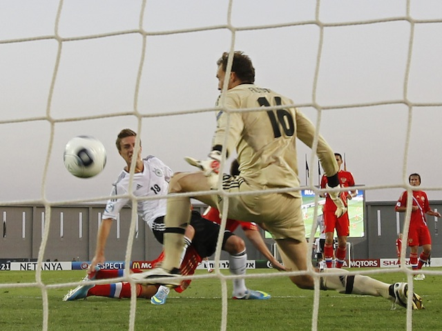 Germany's Patrick Herrmann scores against Russia on June 12, 2013