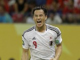 Japan's Shinji Okazaki celebrates scoring his side's 3rd goal during the Confederations Cup match against Italy on June 19, 2013