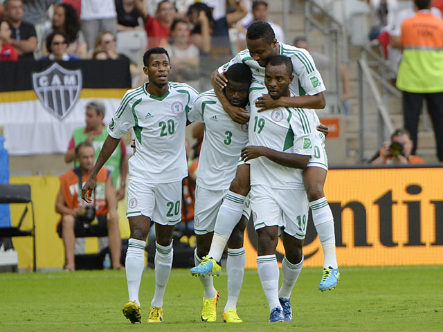 Nigeria's Uwa Echiejile is congratulated by team mates after scoring the opener against Tahiti in the Confederations Cup on June 17, 2013