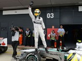 Mercedes driver Lewis Hamilton celebrates after taking pole during qualifying for the British Grand Prix on June 29, 2013