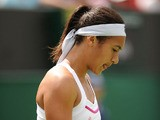 Great Britain's Heather Watson dejected after losing her match against USA's Madison Keys during day two of the Wimbledon Championships on June 25, 2013