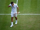 Switzerland's Roger Federer during his match against Ukraine's Sergiy Stakhovsky during day Three of the Wimbledon Championships on June 26, 2013