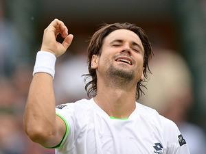 David Ferrer celebrates after beating Alexandr Dolgopolov during their Wimbledon match on June 29, 2013