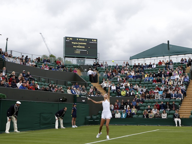 Ana Ivanovic serves against Virginie Razzano at Wimbledon on June 24, 2013