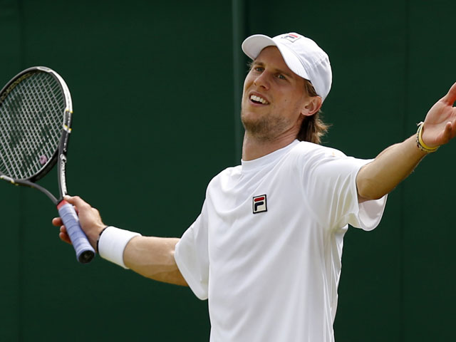 Andreas Seppi of Italy reacts as he plays Kei Nishikori of Japan during their Men's singles match on June 27, 2013