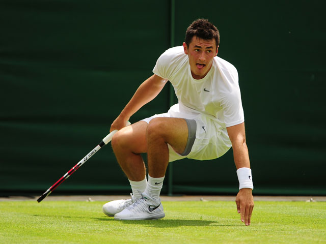 Australia's Bernard Tomic slips in his match against USA's Sam Querrey during the first round of Wimbledon on June 25, 2013