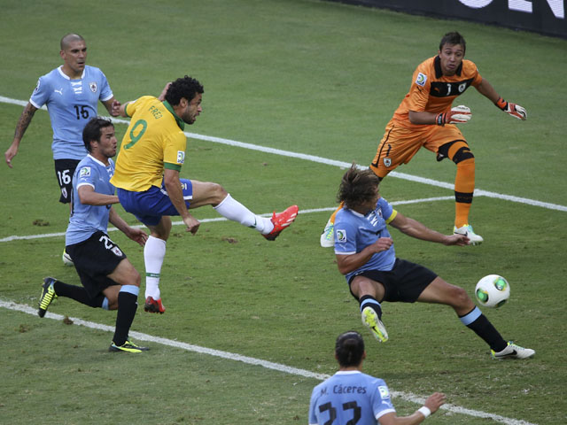 Brazil's Fred scores the opening goal during the soccer Confederations Cup semifinal match between Brazil and Uruguay on June 26, 2013