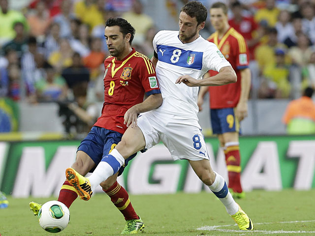 Italy's Claudio Marchisio and Spain's Xavi battle for the ball during their Confederations Cup match on June 27, 2013