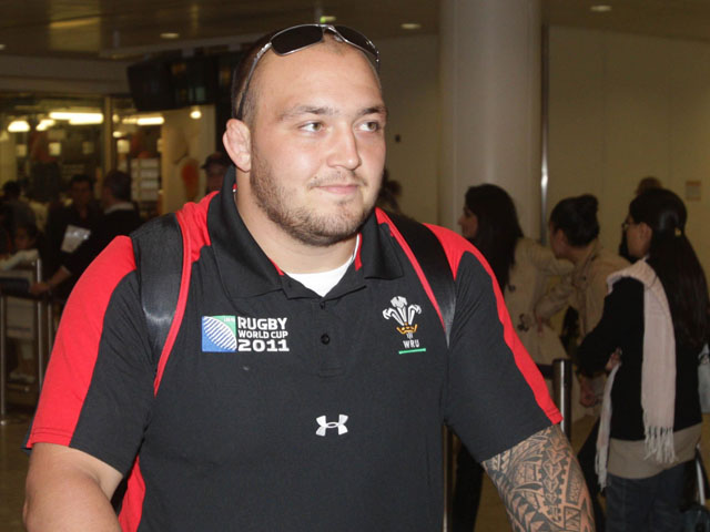 Wales' Craig Mitchell arrives back at Heathrow Airport on October 23, 2011