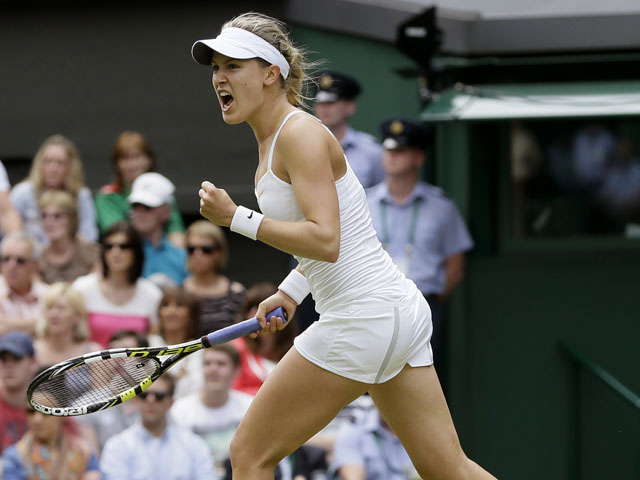 Eugenie Bouchard of Canada celebrates after beating Ana Ivanovic of Serbia in a Women's second round singles match on June 26, 2013