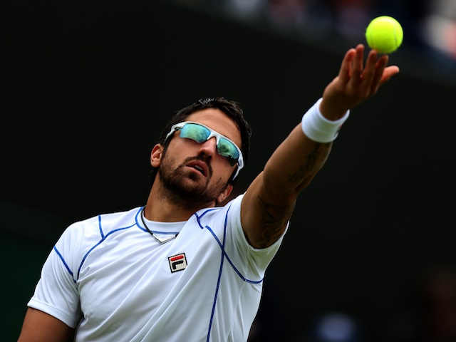 Janko Tipsarevic during his first round loss to Victor Troicki on June 24, 2013