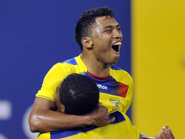 Ecuador's Jefferson Montero celebrates his goal with Antonio Valenciaduring the second half of an international friendly soccer match against Chile on August 15, 2012