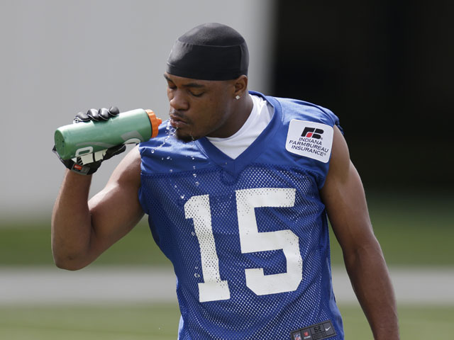 Indianapolis Colts' LaVon Brazill takes a drink of water during NFL practice on May 22, 2013