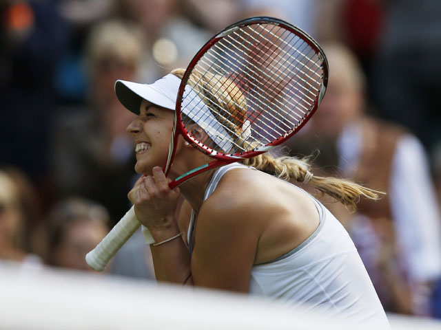 Sabine Lisicki of Germany celebrates after beating Samantha Stosur of Australia during their Women's singles match on June 29, 2013