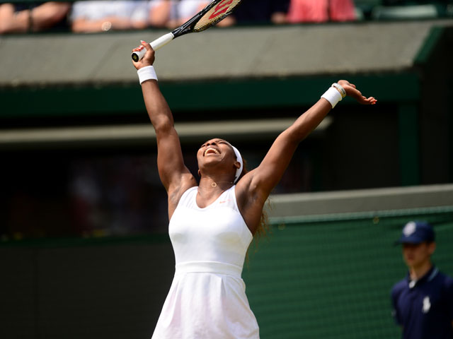 USA's Serena Williams celebrates in her second round match against France's Caroline Garcia at Wimbledon on June 27, 2013