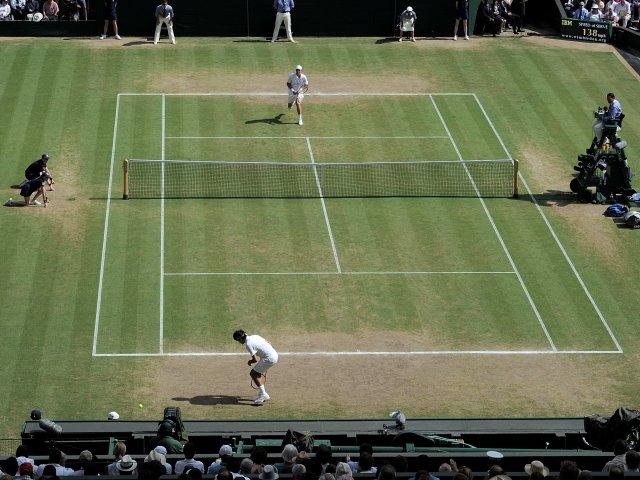 Tomas Berdych plays a winner against Roger Federer at Wimbledon.