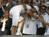 Andy Murray of Britain embraces his coach Ivan Lendl after defeating Novak Djokovic of Serbia during the Men's singles final match on July 7, 2013