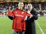 Kayden Jackson being unveiled as a Swindon Town player.
