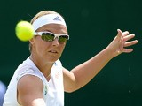 Belgium's Kirsten Flipkens in action against Italy's Flavia Pennetta during day seven of the Wimbledon Championships on July 1, 2013