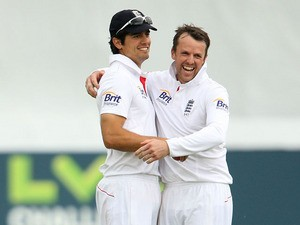 England's Alastair Cook and Graeme Swann celebrate a wicket during day four of the International Tour match against Essex on July 3, 2013