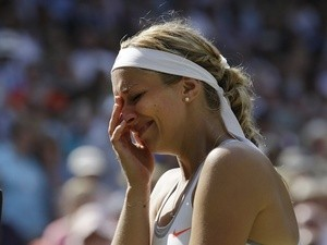 Sabine Lisicki cries following her loss in the Wimbledon final on July 6, 2013