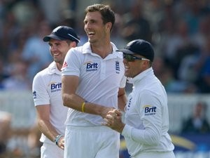 Steven Finn, James Anderson and Graeme Swann celebrate against South Africa.