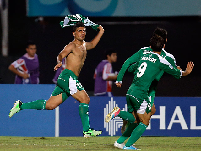 Iraq's Farhan Shakor celebrates moments after scoring the opening goal against Paraguay during the U20 World Cup on July 3, 2013