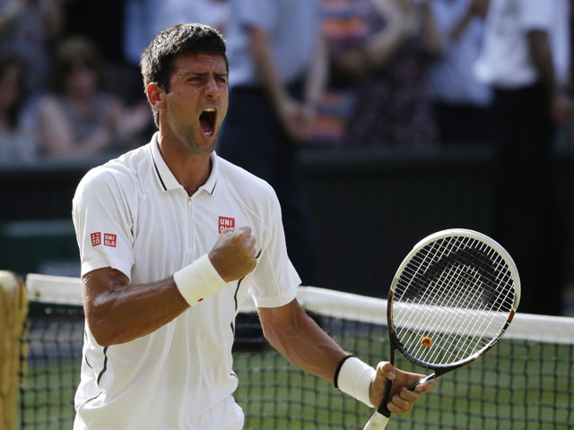 Novak Djokovic of Serbia reacts after defeating Juan Martin Del Potro of Argentina in their Men's singles semifinal match at the All England Lawn Tennis Championships on July 5, 2013