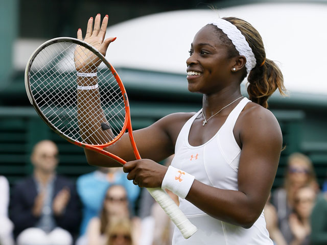 Sloane Stephens of the United States smiles after beating Monica Puig of Puerto Rico in a Women's singles match on July 1, 2013