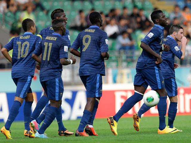 France players react after Kurt Zouma scored their fourth goal during the Under-20 World Cup quarterfinals match between France and Uzbekistan on July 6, 2013
