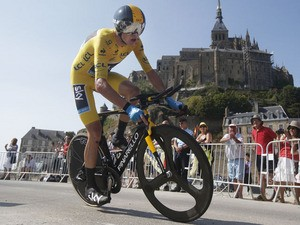 Britain's Chris Froome passes world heritage site Mont-Saint-Michel during the eleventh stage of the Tour de France on July 10, 2013