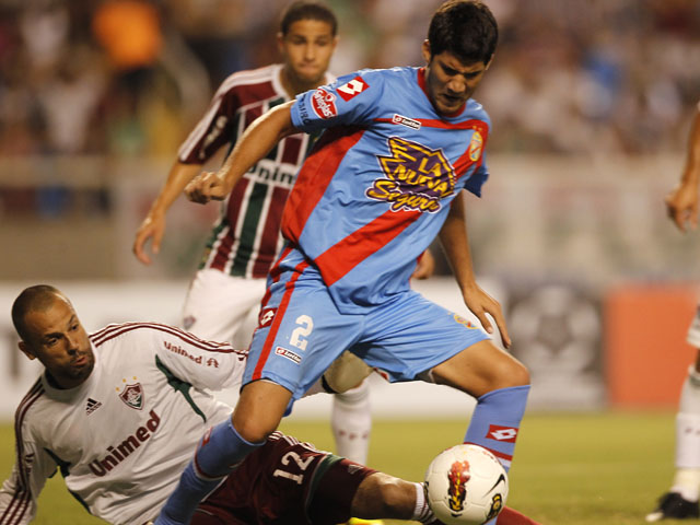 Argentina's Arsenal's Lisandro Lopez during a Copa Libertadores match against Fluminense on February 7, 2012