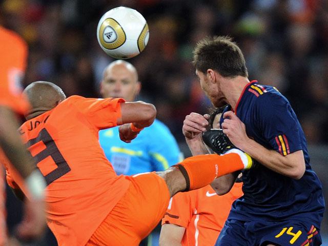 Netherlands' Nigel de Jong fouls Spain's Xabi Alonso during the World Cup final on July 11, 2010