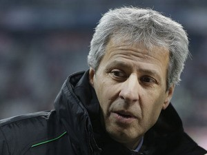 Moenchengladbach head coach Lucien Favre of Switzerland arrives the stadium prior to the Bundesliga match against Bayern Munich on December 14, 2012